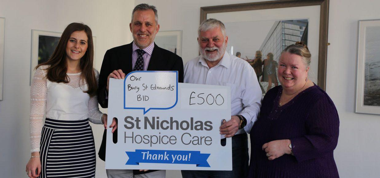 tom murray cheque presentation st nicholas hospice care