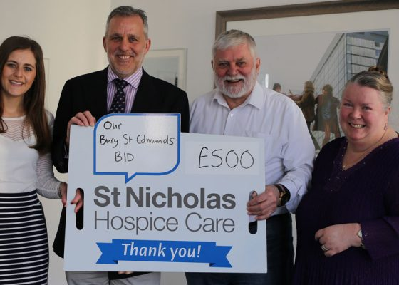 tom murray cheque presentation st nicholas hospice care