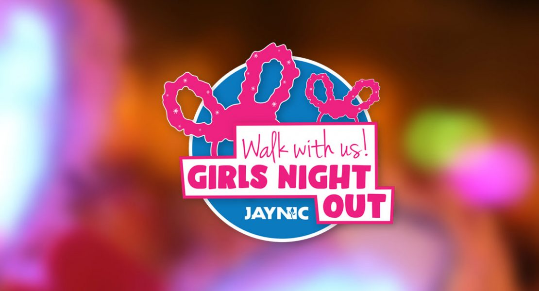 girls night out logo with blurry bunny ears in background